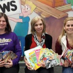 Mrs. Counterman presents donated books to Ms. Steeger and Ms. Watson at West Memorial Elementary.